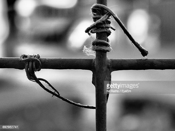Close-Up Of Rope Tied Up On Fence