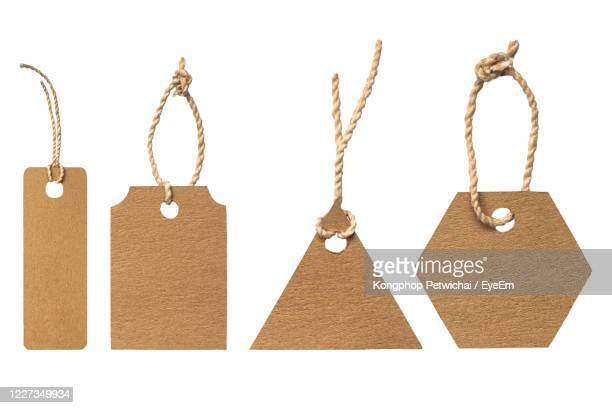close-up of ropes hanging on rope against white background - brown stock pictures, royalty-free photos & images