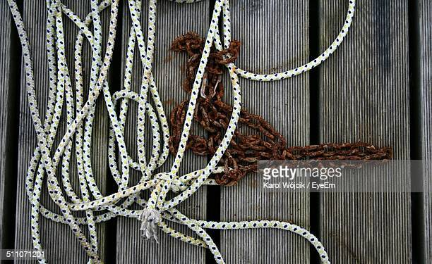 Close-up of ropes on wooden surface
