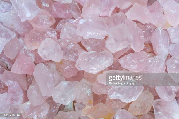 close-up of rose quartz crystals - rose colored stock pictures, royalty-free photos & images