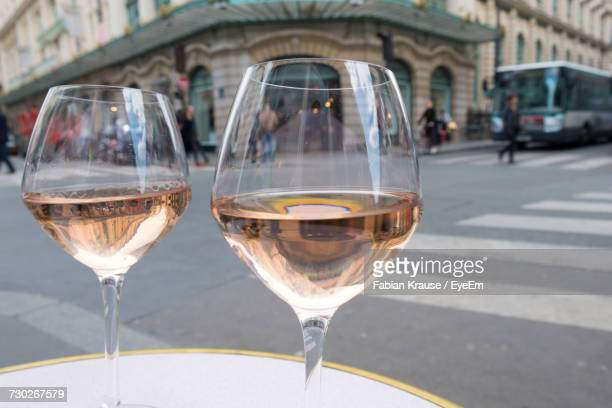 Close-Up Of Rose Wine In Glass On Table In Sidewalk Cafe