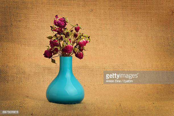 Close-Up Of Roses In Vase On Burlap Sack