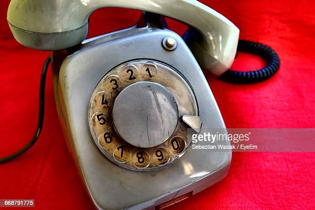 close-up of rotary phone on red fabric - sebastian grey stock pictures, royalty-free photos & images