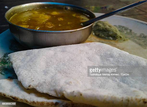 Close-Up Of Roti With Curry In Plate