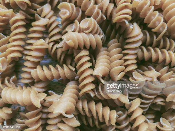 close-up of rotini pasta - whole wheat stock pictures, royalty-free photos & images
