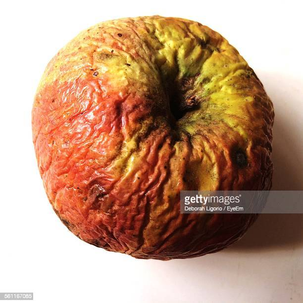 Close-Up Of Rotten Apple On White Background