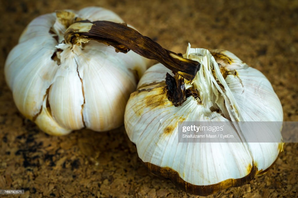 Close-Up Of Rotten Garlic Bulbs : Stock Photo