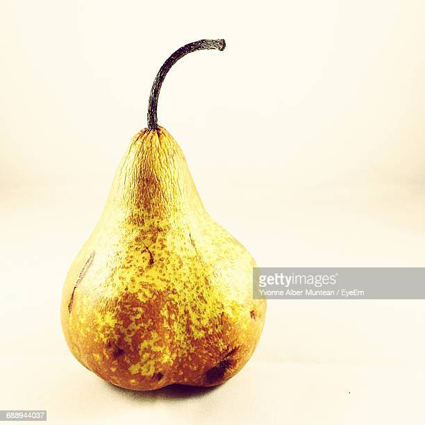 Close-Up Of Rotten Pear Against White Background