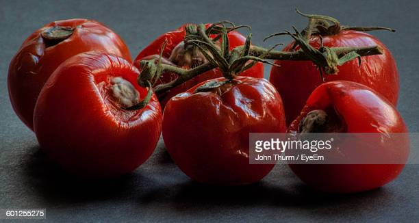 Close-Up Of Rotten Tomatoes On Table