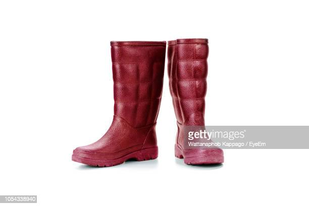 close-up of rubber boots against white background - stiefel stock-fotos und bilder