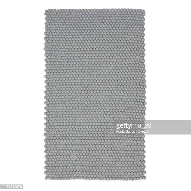 close-up of rug against white background - rug stock pictures, royalty-free photos & images