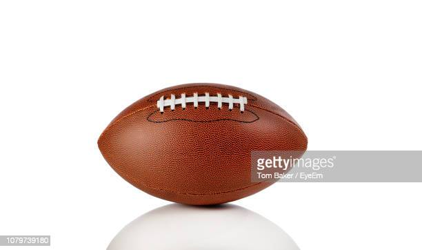 close-up of rugby ball against white background - ラグビーボール ストックフォトと画像