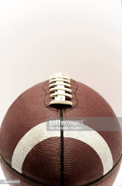 Close-Up Of Rugby Ball Against White Background