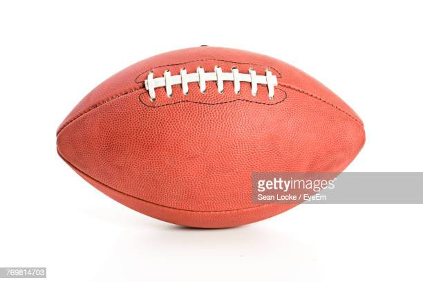 close-up of rugby ball over white background - rugby sport stock pictures, royalty-free photos & images