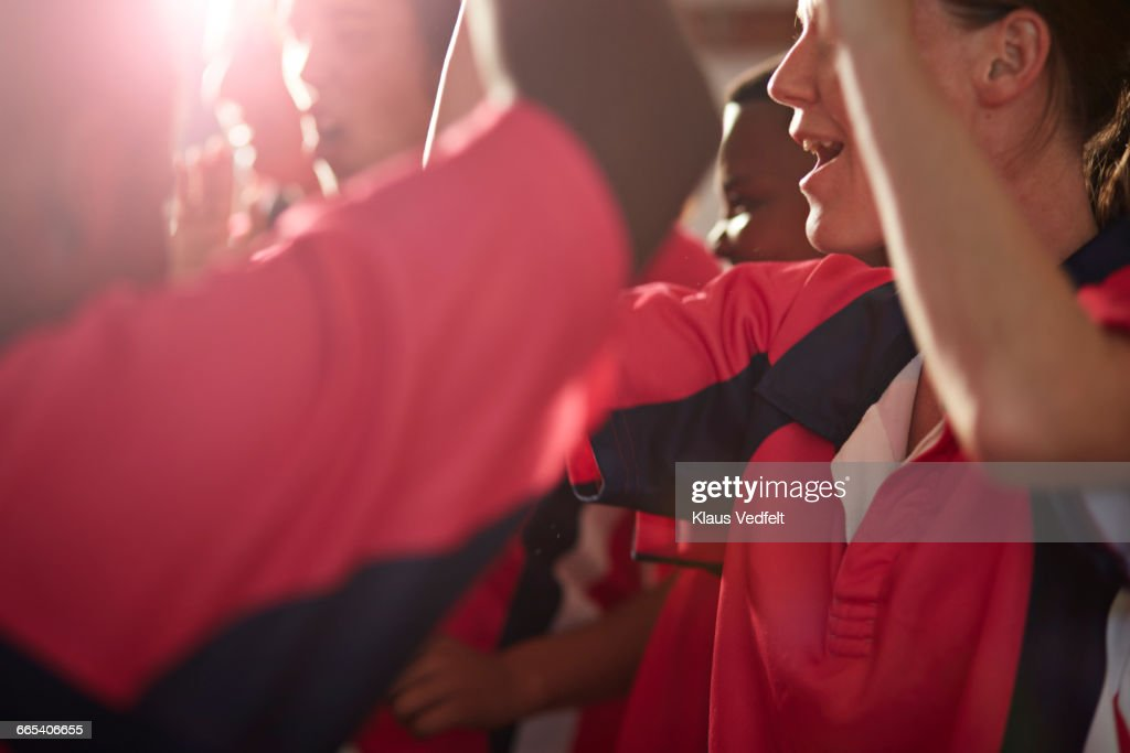 Close-up of rugby team cheering after game : Stock Photo