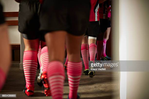 close-up of rugby teams legs, walking out - rugby players in changing room stock photos and pictures