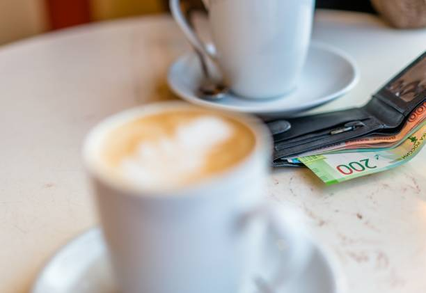 Close-Up Of Russian Currency Roubles In Wallet On Table In Cafe