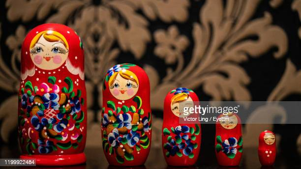 close-up of russian nesting dolls on table - babushka stock pictures, royalty-free photos & images
