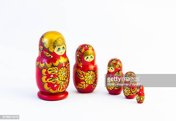 Close-Up Of Russian Nesting Dolls On White Background