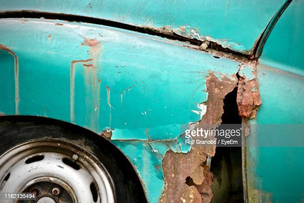 close-up of rusty abandoned car - rusty stock pictures, royalty-free photos & images