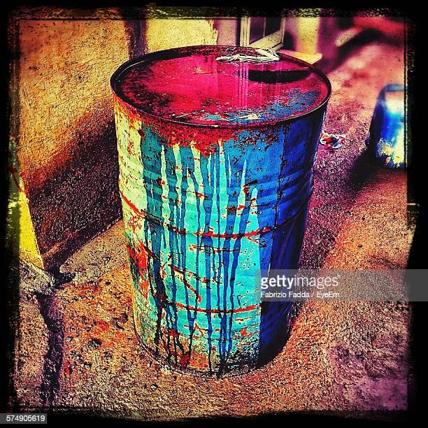 Close-Up Of Rusty Barrel Full Of Colored Water