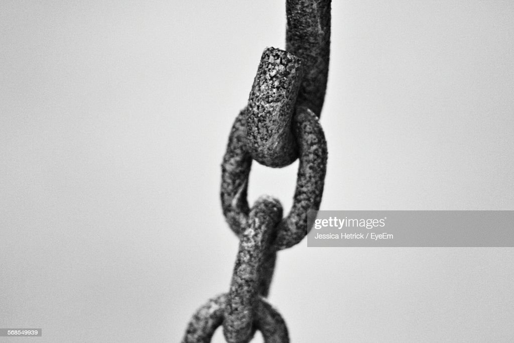 Close-Up Of Rusty Chain Against White Background : Stock Photo