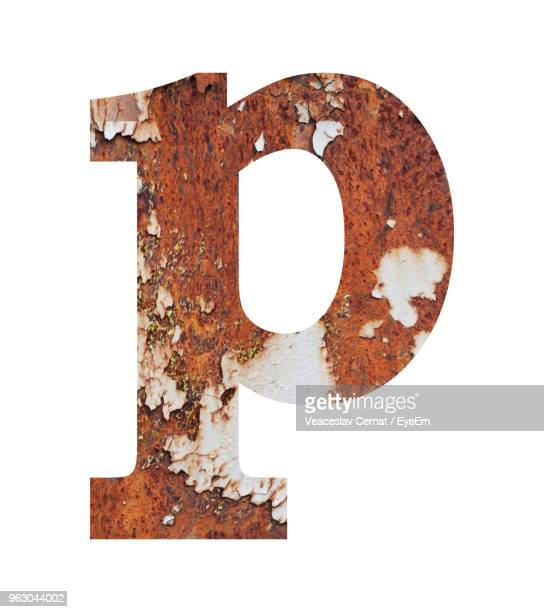 close-up of rusty letter p against white background - letra p fotografías e imágenes de stock