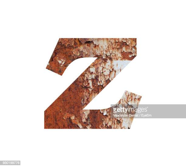 Close-Up Of Rusty Letter Z Against White Background