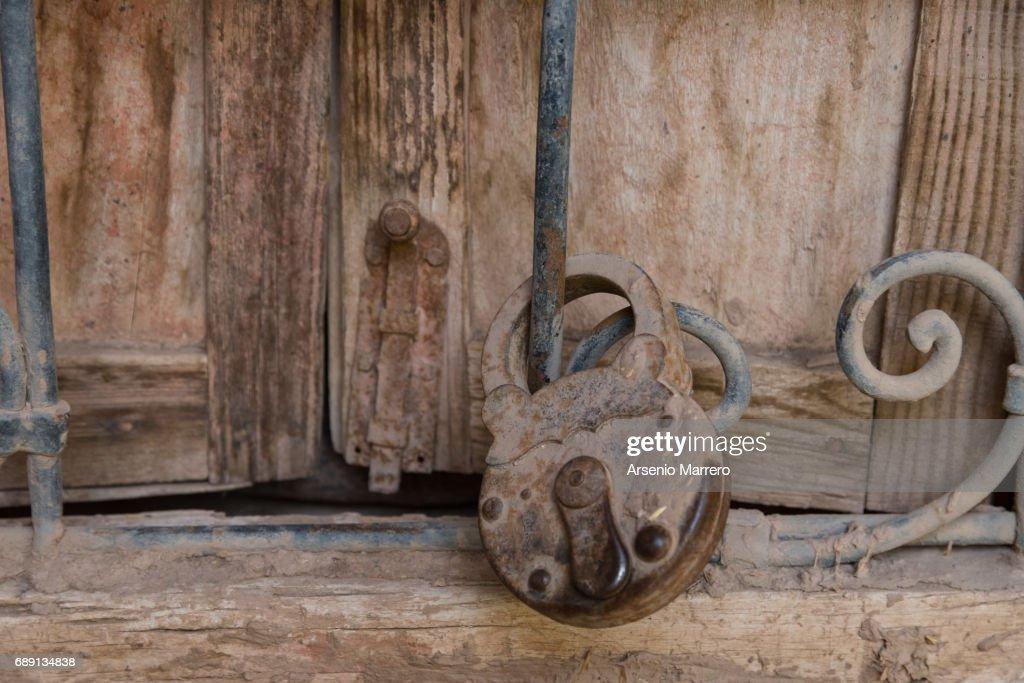 Close-Up Of Rusty Lock On Wooden Door : Stock Photo