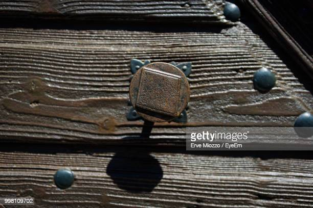 Close-Up Of Rusty Metal On Wooden Table