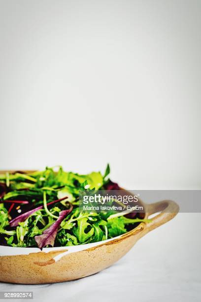 Close-Up Of Salad In Bowl Against White Background
