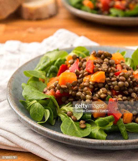 close-up of salad in plate on table - lentil stock pictures, royalty-free photos & images