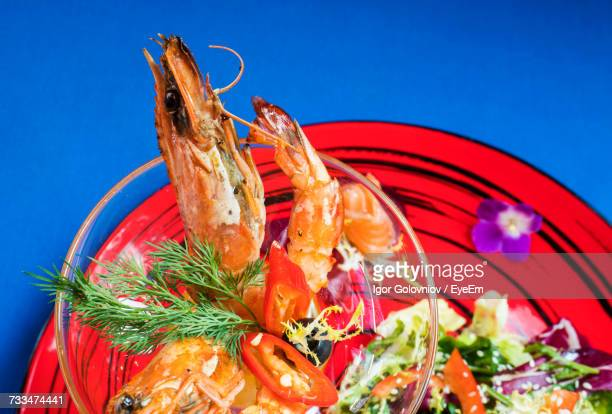 close-up of salad in plate on table - igor golovniov stock pictures, royalty-free photos & images