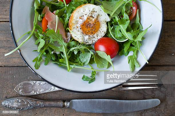 Close-up of salat with rucola,egg and tomato