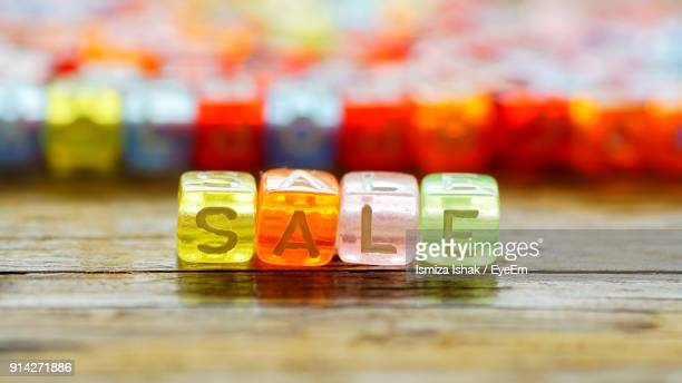 Close-Up Of Sale Text On Colorful Blocks Over Table
