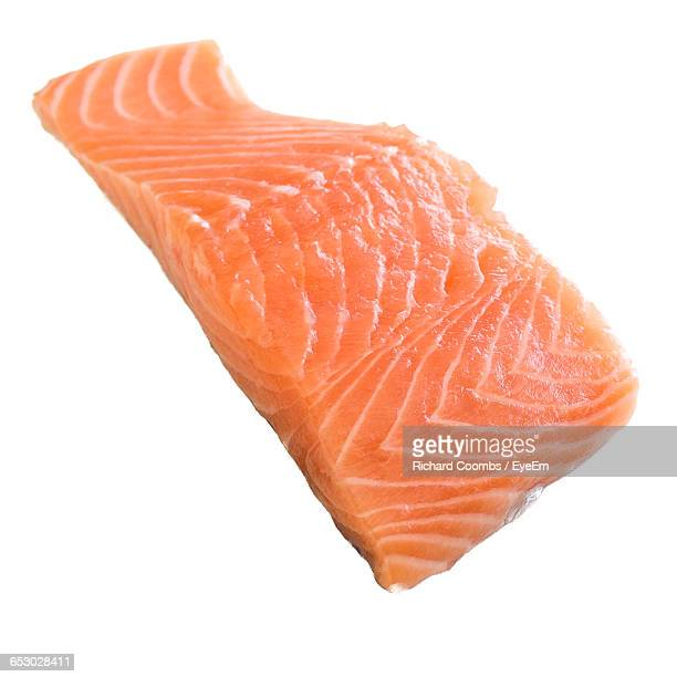 Close-Up Of Salmon Steak Against White Background