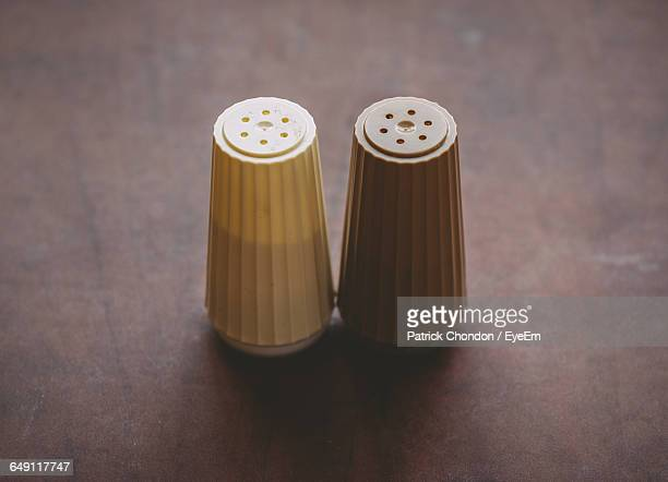 close-up of salt and pepper shakers on table - salt and pepper shakers stock pictures, royalty-free photos & images