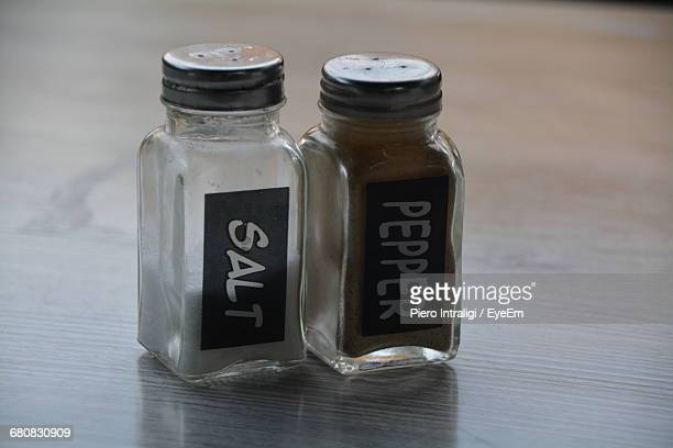 Close-Up Of Salt And Pepper Shakers On Table