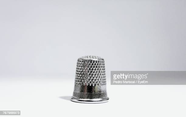 close-up of salt shaker over white background - thimble stock photos and pictures
