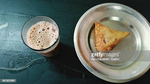 close-up of samosa served with tea - samosa stock photos and pictures