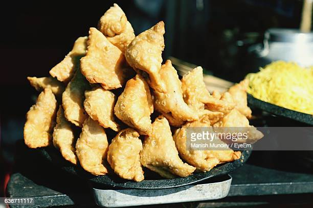 Close-Up Of Samosa Stacked On Plate For Sale