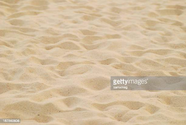 Close-up of sand in the shape of waves on the beach