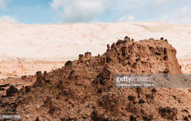close-up of sand on beach against sky - chanayut stock photos and pictures
