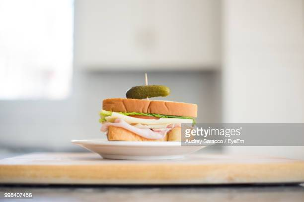 close-up of sandwich in plate on table - pickles stock photos and pictures