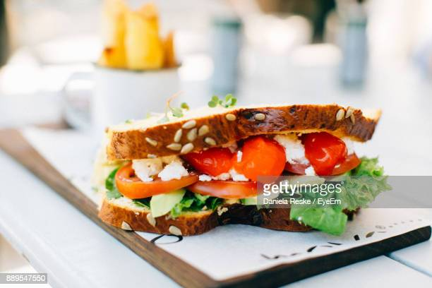 close-up of sandwich on cutting board - sandwich stock pictures, royalty-free photos & images