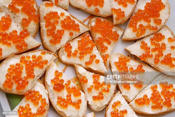Close-up of sandwiches with salmon caviar toppings, Kiev, Ukraine