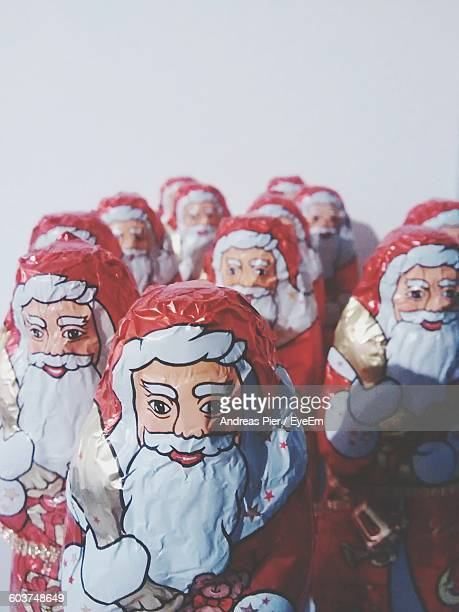 Close-Up Of Santa Claus Chocolate Against White Background