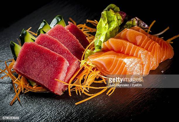 Close-Up Of Sashimi On Wooden Plate