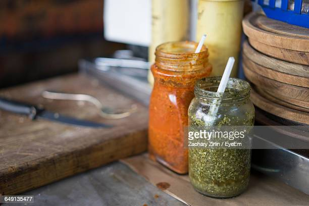 Close-Up Of Sauce Jars On Table