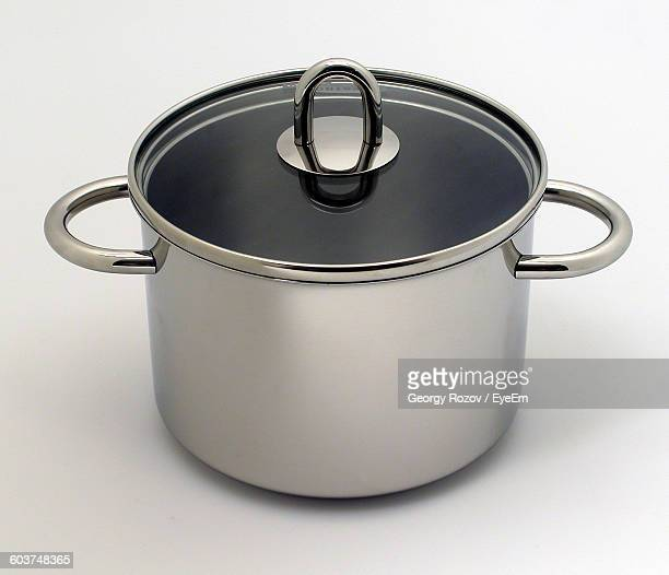 Close-Up Of Saucepan Against White Background